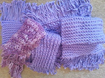 Our volunteers have been busy knitting for our raffle