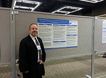 Dr. Robert Trobliger with poster of stress coping in epilepsy