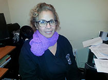 Dr. Lizardo wears her purple scarf proudly