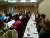 Child Epileptologist speaks to a full room on Autism and epilepsy