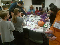 Busy hands painting pumpkins for epilepsy