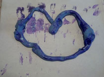 Play doh and purple paint make this heart